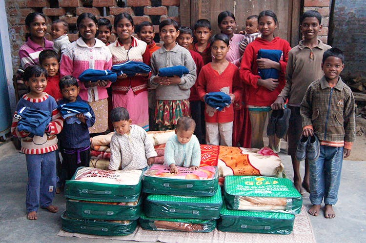 A City Club Distributed Clothes to 500 Orphan Children before Durga Puja in Kolkata