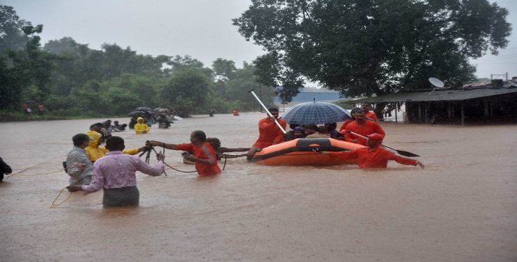 India: Navy Rescues People Stranded on Train in Floods